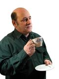 Savoring the taste. A man savoring the taste of a cup of coffee,over white Royalty Free Stock Image