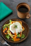 Healthy breakfast with waffles and poached egg. Savory belgian waffles with salad and poached egg on a table Royalty Free Stock Photography