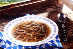 Savory boiled liver spaetzle in broth Royalty Free Stock Image
