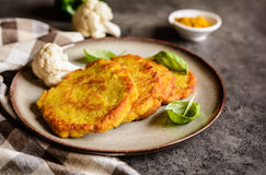 Savory cauliflower pancakes with curry Royalty Free Stock Images