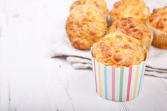 Savory cheese and bacon muffins on the white table Royalty Free Stock Photo