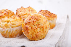 Savory cheese and bacon muffins on the white table Stock Image