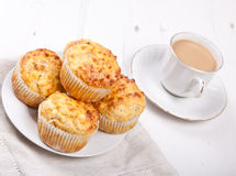 Savory cheese and bacon muffins on the white table Stock Images