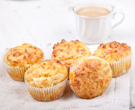 Savory cheese and bacon muffins on the white table Royalty Free Stock Images