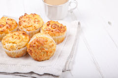 Savory cheese and bacon muffins on the white table Stock Photo