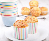Savory cheese and bacon muffins on the white table Stock Photos