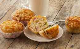 Savory cheese and bacon muffins. On the wooden table Stock Photography