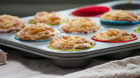 Savory cheese and bacon muffins. On the wooden table Royalty Free Stock Image