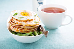 Savory cheese pancakes with egg Stock Photos