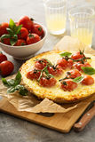Savory cheese tart with cherry tomatoes Stock Image