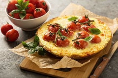 Savory cheese tart with cherry tomatoes Stock Images