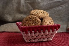 Savory cookies sprinkled with sesame seeds, sunflower on table and burlap background. Savory cookies sprinkled with sesame seeds, sunflower on a wooden table and Stock Image