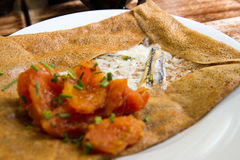 Savory crepe. With cream cheese, anchovy and tomato Stock Photography