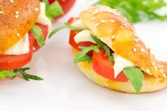 Savory croissant with tomato, arugula and cheese Stock Photography