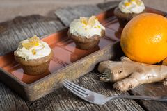 Savory ginger cupcakes with cream cheese frosting Stock Image