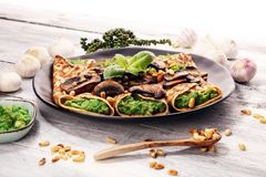 Savory Homemade Mushroom and Spinach Crepes with Cheese and avoc royalty free stock photos
