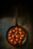 Savory meatballs in a piquant sauce Stock Photography