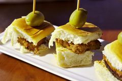 Delicious meatloaf sliders. Savory meatloaf sliders with tasty olive accent Royalty Free Stock Photos