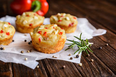 Savory muffins with Feta cheese, curd, pepper and herbs Stock Photos