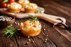 Savory muffins with Feta cheese, curd, pepper and herbs. Savory Feta cheese muffins with curd, red bell pepper and herbs Royalty Free Stock Photo