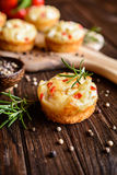 Savory muffins with Feta cheese, curd, pepper and herbs Stock Photography
