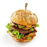 Savory mushroom burger with sliced fungi. Layered over a thick succulent beef patty  on white Stock Photos