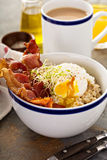 Savory oatmeal porridge with egg and bacon Royalty Free Stock Images