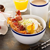 Savory oatmeal porridge with egg and bacon Stock Photos