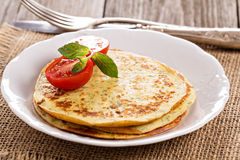 Savory pancakes with tomatoes Stock Photography