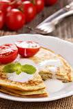 Savory pancakes with tomatoes Stock Image