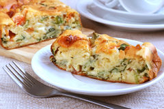 Savory Pie With Cheese, Tomatos And Ramsons. On the table Royalty Free Stock Photos