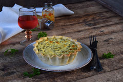 Savory pie tart with spring greens, meat, cheese, onion leek and pepper. Chard quiche for dinner or lanch on wooden. Background. Copy space for your text Royalty Free Stock Photos