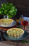 Savory pie tart with spring greens, meat, cheese, onion leek and pepper. Chard quiche for dinner or lanch on wooden. Background. Copy space for your text Royalty Free Stock Photo