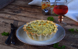 Savory pie tart with spring greens, meat, cheese, onion leek and pepper. Chard quiche for dinner or lanch on wooden. Background. Copy space for your text Stock Photo