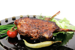 Savory plate: grilled ribs over black Stock Photography