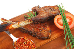 Savory plate on wood : grilled ribs Stock Photography