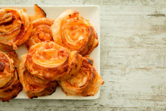 Savory puff pastries spiral shaped Stock Photo