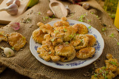 Savory puff pastry. Angel, star and balls, sprinkled seeds and cumin, young herbs, fresh orange juice Stock Images