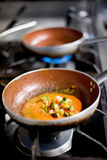 Savory sauce for Italian pasta on a burner royalty free stock images
