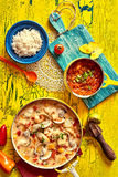 Savory Seafood Dish on Yellow Table with Garnishes Stock Photography