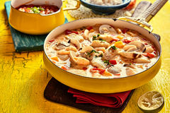 Savory Seafood Sauce on Yellow Table with Garnish Royalty Free Stock Photo
