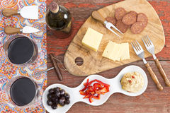 Savory snacks on a rustic table with red wine Royalty Free Stock Photos