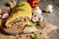 Savory strudel with mushrooms, red pepper, onion, garlic and parsley Royalty Free Stock Photo
