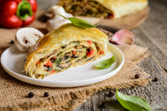 Savory strudel with mushrooms, red pepper, onion, garlic and parsley Stock Images