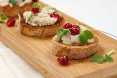 Savory Tuna Salad Crostini. Wooden tray with three savory tuna salad crostini on white Stock Photos