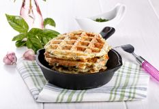 Savory vegetable waffles with cheese and herbs royalty free stock photography