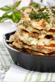 Savory vegetable waffles with cheese and herbs royalty free stock photos