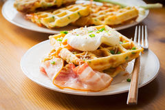 Savory waffles with bacon, egg and cheese Stock Image