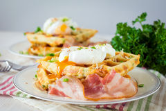 Savory waffles with bacon, egg and cheese Stock Images