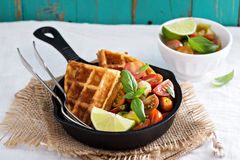 Savory waffles with cheese and cornmeal. Served with tomato salsa Royalty Free Stock Photography